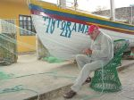 800px-Fisherman_Repairs_His_Nets_-_Armacao_-_Santa_Catarina_Island_-_Brazil